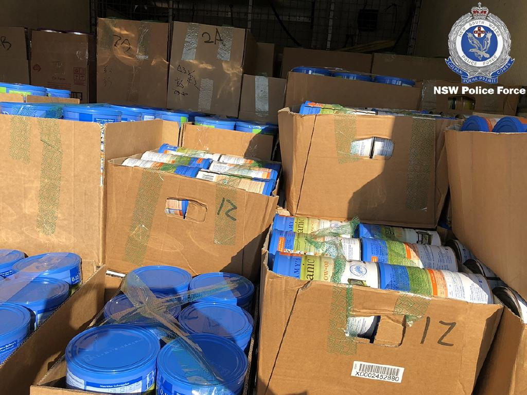 Police located more than 4000 tins of baby formula, large quantities of vitamins, Manuka honey, and various other items, all of which are believed to be stolen. Picture: NSW Police