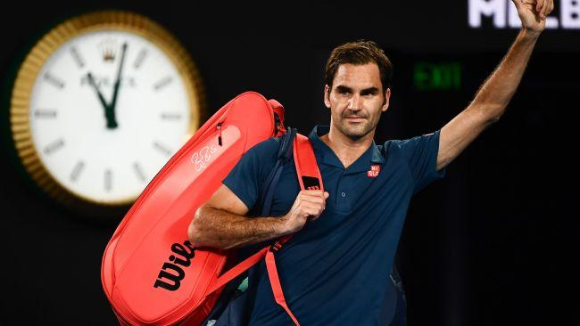 Roger Federer waves goodbye to the Melbourne Park crowd. Picture: AAP Images