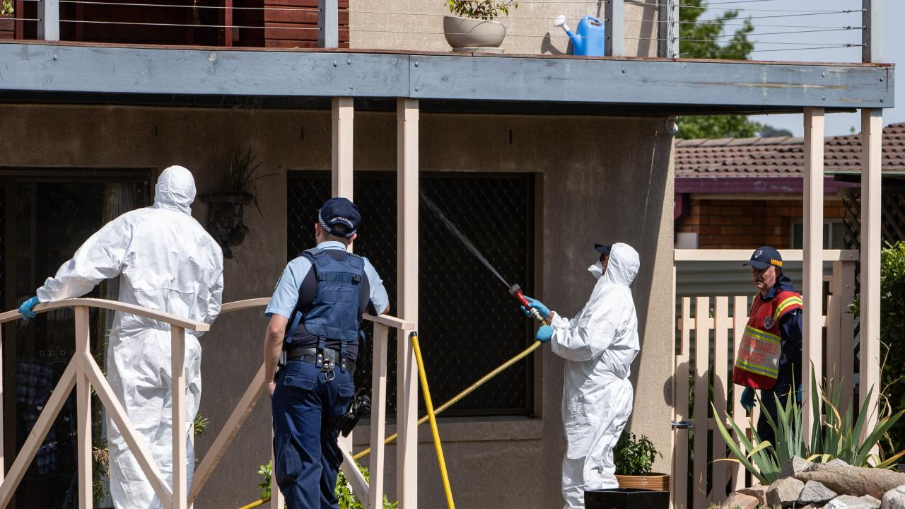 NSW Fire and Rescue officers clear up the crime scene at the house in Glen Innes where Eric Newman shot at two police officers before turning the gun on himself. Picture: Julian Andrews