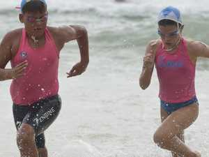 Nippers compete in the under-11 swim race during the