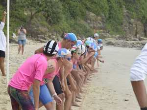 Nippers line up for the under-12 swim race during the