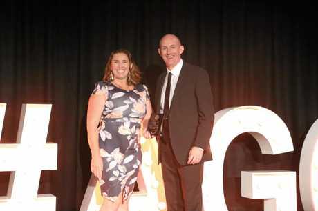 AWARD WINNER: Sunshine Coast PCYC head gymnastics instructor Clare George and Greg Hill (Gymnastics Australia Chief Operating Officer).