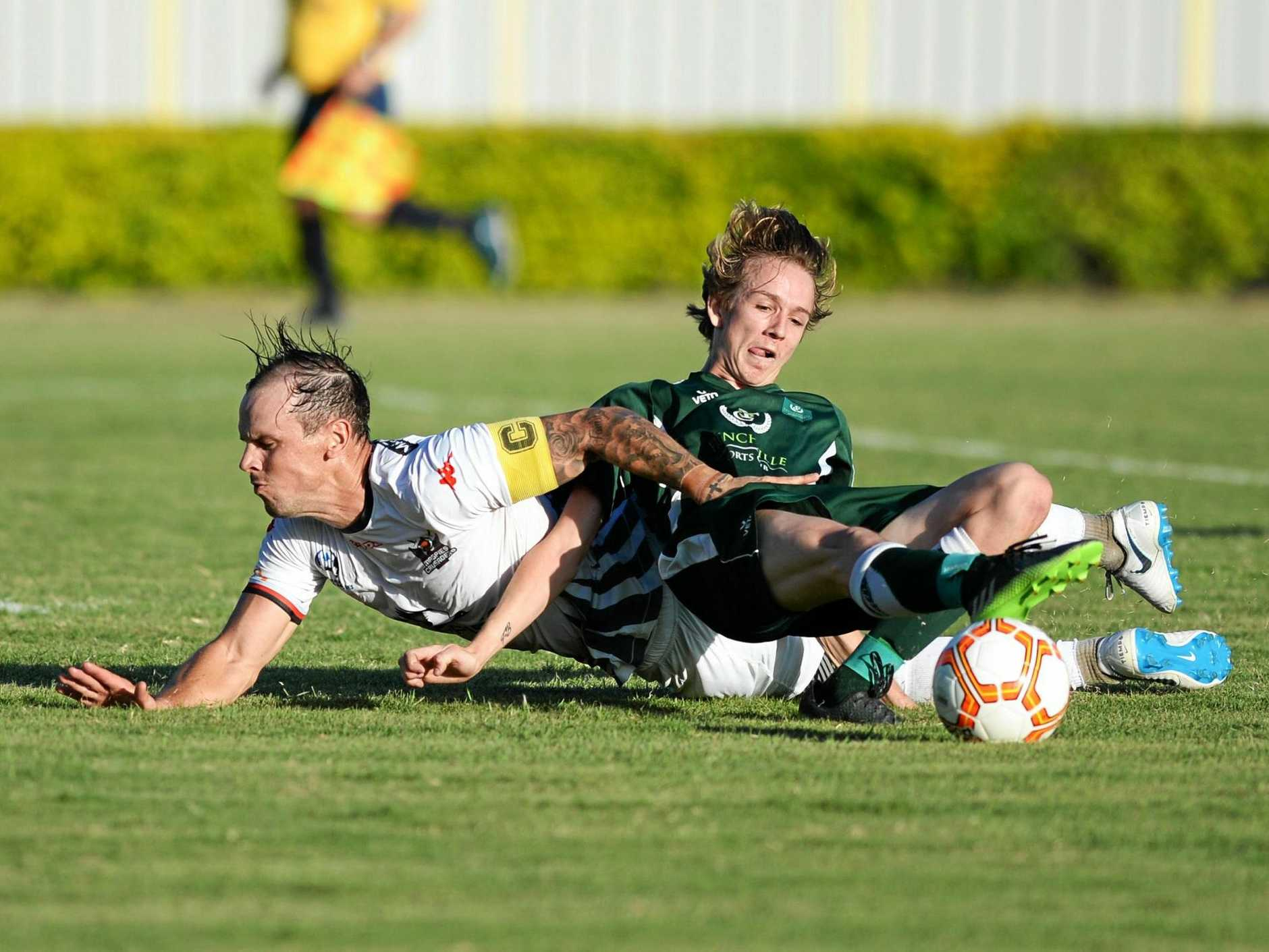 DETERMINED EFFORT: Frenchville's Sam Reynolds continues to battle for possession despite hitting the deck in the pre-season friendly against the Magpies United Crusaders at Ryan Park on Saturday.