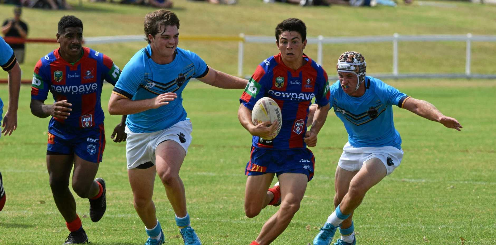 OFF AND GONE: Lachlan Crouch races away for the Newcastle Knights U16s team on Sunday against the Gold Coast Titans in Coffs Harbour.