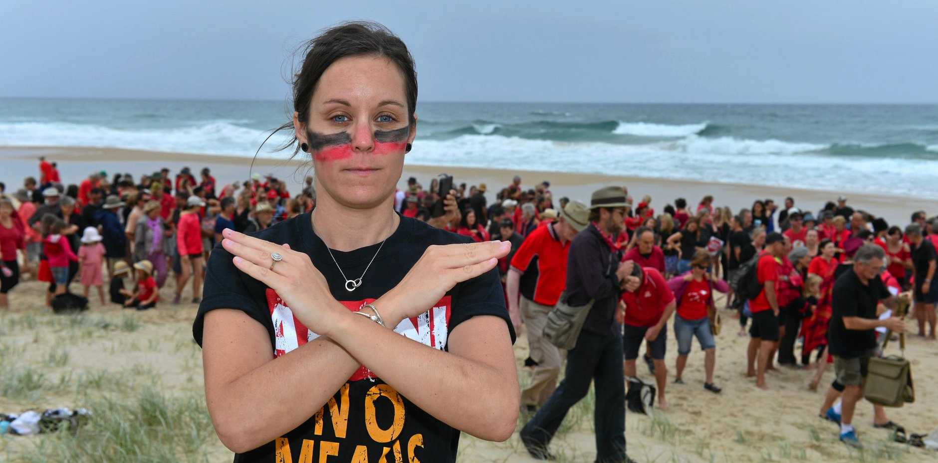 FILE PHOTO: Volunteers are needed to make a human sign at Peregian Beach to spread the importance of renewable energy.