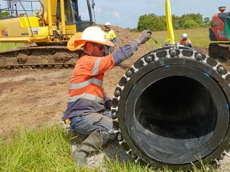A Unitywater worker repairs a major water supply pipe, installed only a year ago, at Finland Road on the weekend.