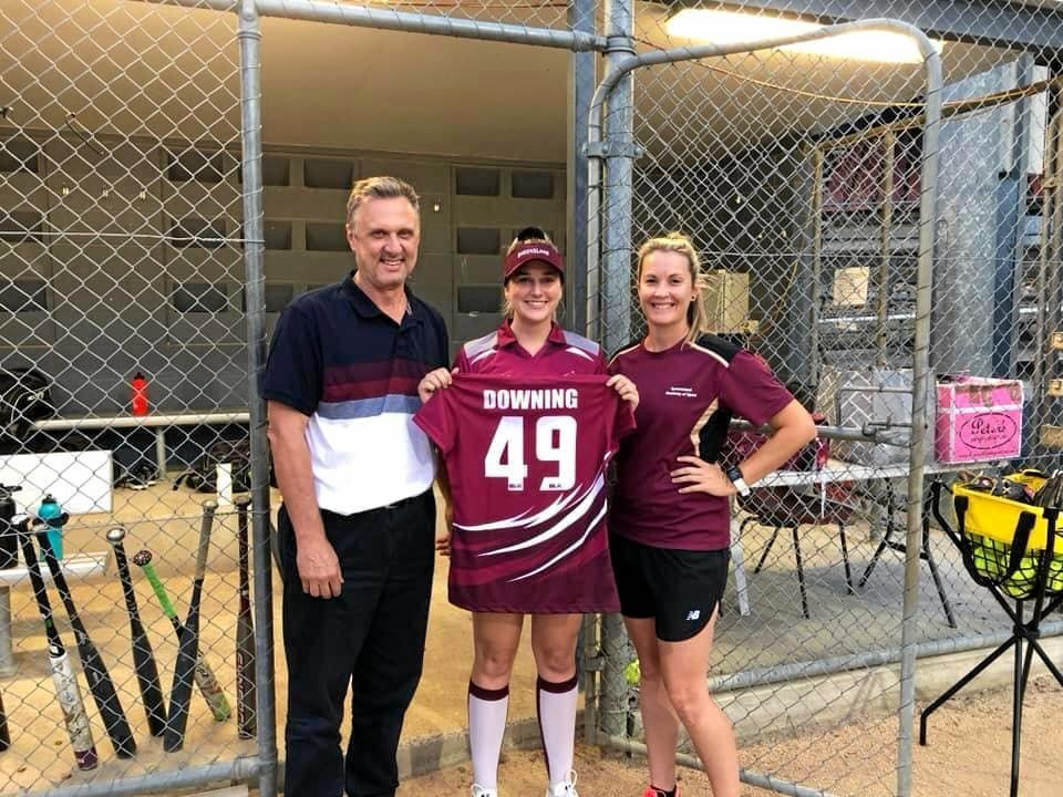HONOUR: Chyanne Downing recieves her strip from ex-Australian and Qld Heat captain Melinda Weaver.