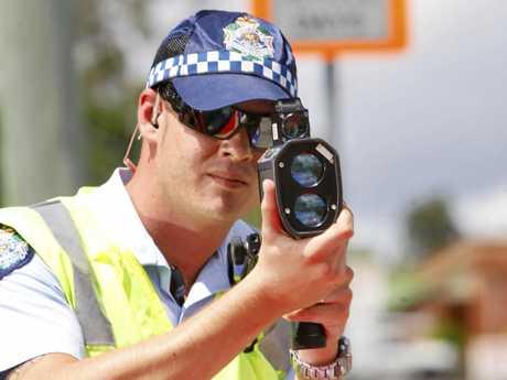 Ipswich Traffic Branch officer conducting speed checks at local school zones. Photo: David Nielsen / Queensland Times IPS140311RADA14C