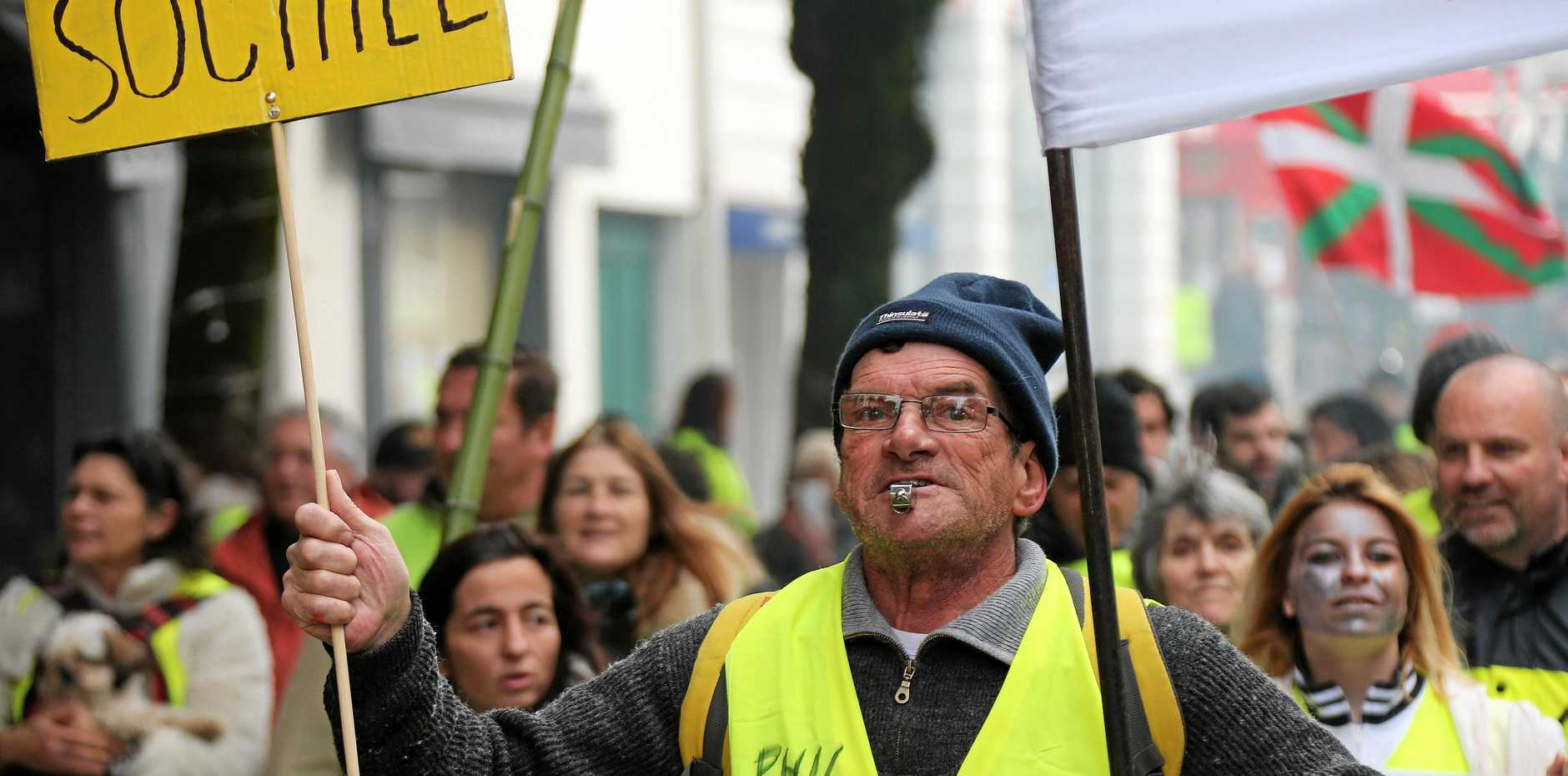 FIRED UP: A yellow vest protester demonstrates in Saint Jean De Luz, France, on Saturday. Yellow vest protesters are planning rallies in several French cities despite a national debate launched this week by President Emmanuel Macron aimed at assuaging their anger.