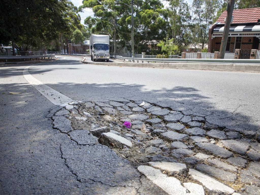 A damaged road surface at Booth Street, Annandale, on Monday. Picture: Justin Lloyd