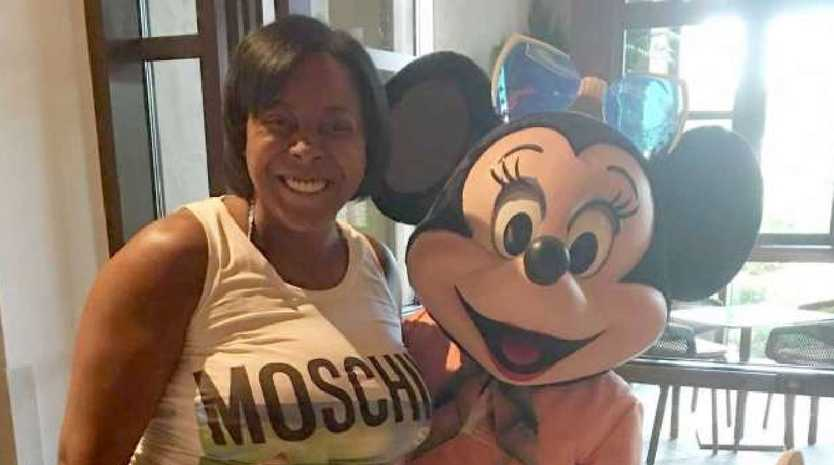 Keisha Williams, 43, of Ashburn, on a 2016 trip to Disney World she paid for through fraudulent funds. Picture: US Attorney's Office for the Eastern District of Virginia