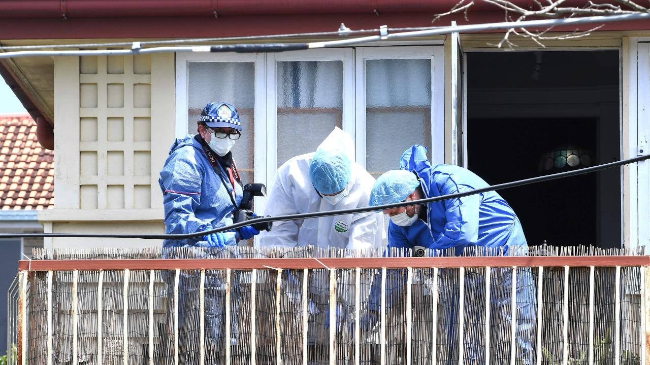 Detectives at the house on Hunter St, Kelvin Grove, where Mr Frescon's body was found. Picture: AAP image, John Gass