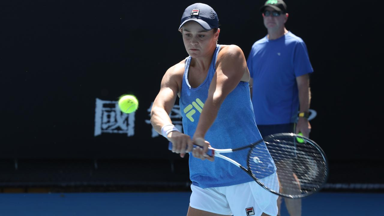 Ashleigh Barty of Australia in action during a practice session while coach Craig Tyzzer watches on. Picture: AAP