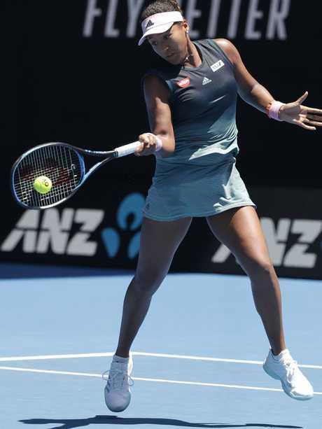 Japan's Naomi Osaka makes a forehand return.