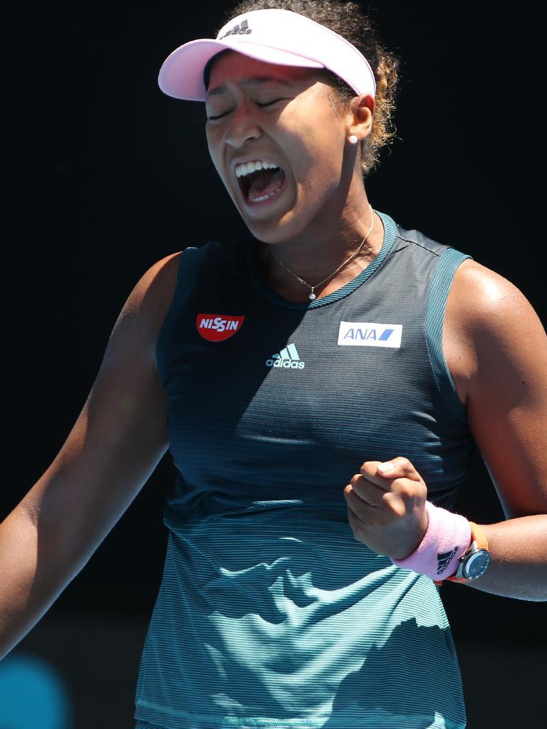 Naomi Osaka celebrates winning a big point.