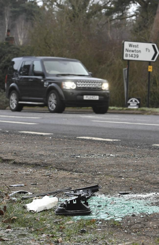 Broken glass and car parts on the road side near the royals' Sandringham estate. Picture: AP