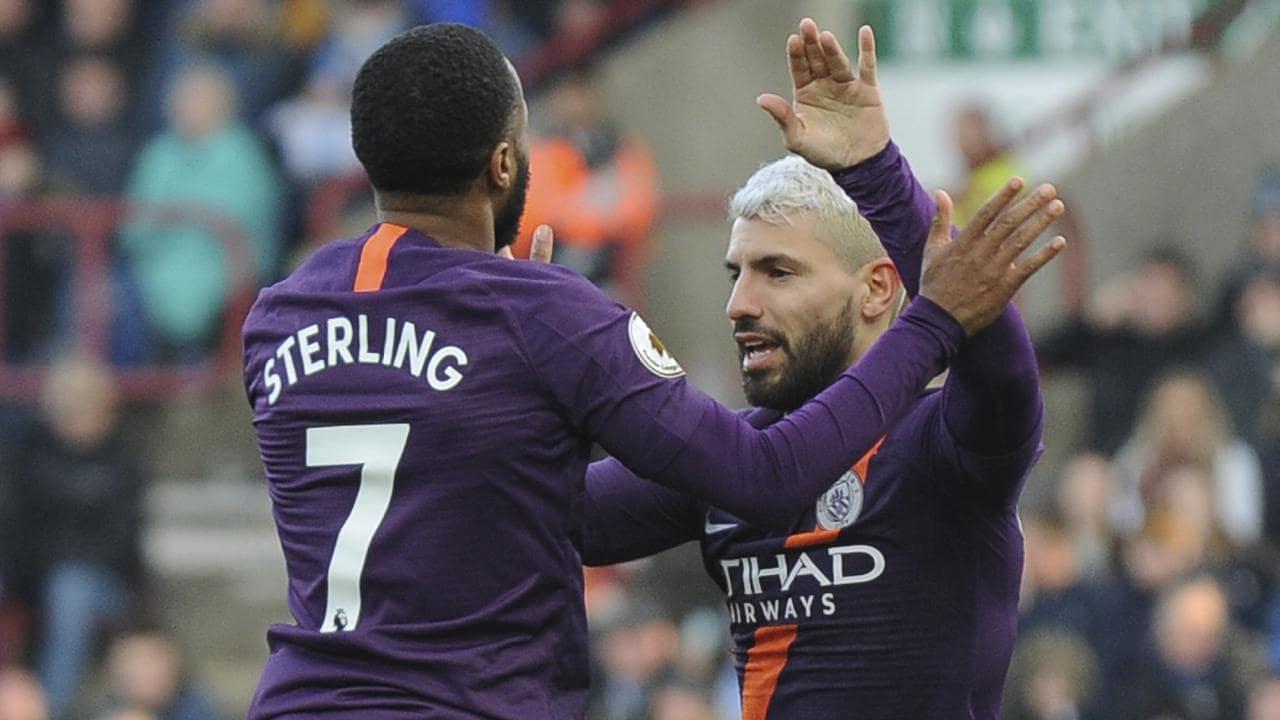 Raheem Sterling, left, celebrates with Sergio Aguero. (AP Photo/Rui Vieira)