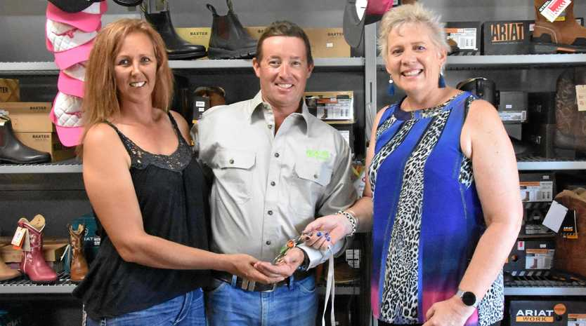 HANDING OVER THE REINS: Desley O'Grady has sold her shop to local horse trainers Leigh and Kelly Jephson.