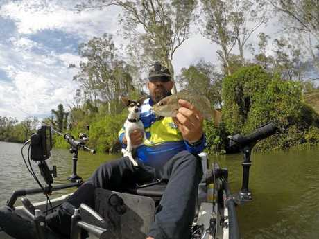 Ron Hess, with his dog Roxy, showing off the jack caught at the Calliope river.