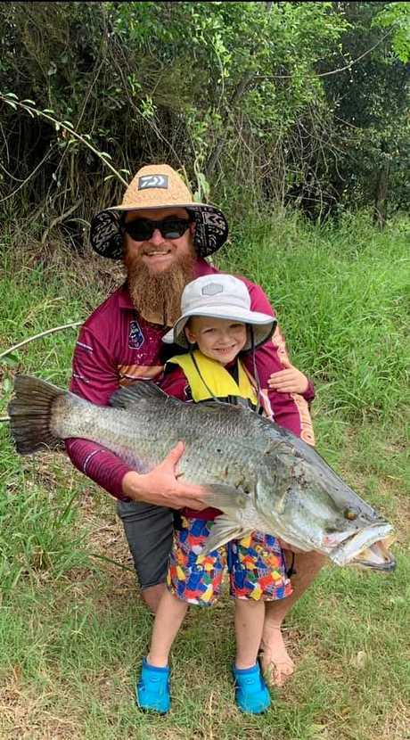 BIG BOY: Rob Birmingham and his son Jack with a 101cm barra caught in the Boyne River.