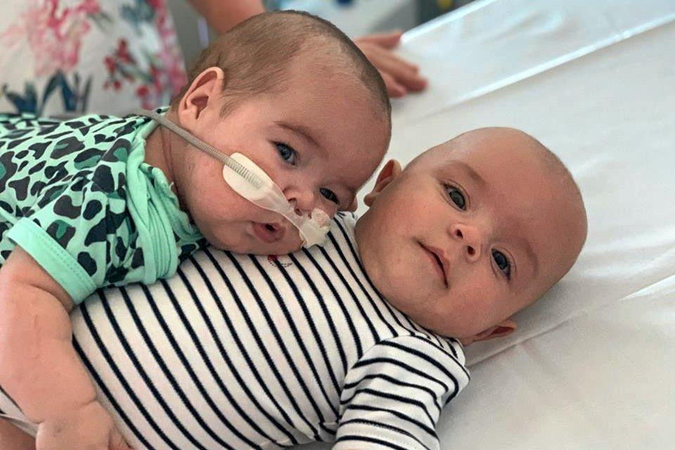 SPECIAL BOND: Twin boys Archie and Henry du Preez, moments before Archie fell asleep on his big brother's lap.