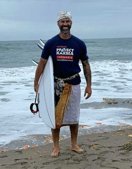 Paddle Against Child Abuse founder Damien Rider sets out on a paddle in Bali.