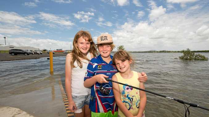 Siblings Amy Tetley, 11, Allan, 9, and Briana, 7, enjoyed some fun in the water at the River Street boat ramp during yesterday's 6.52 metre tide.