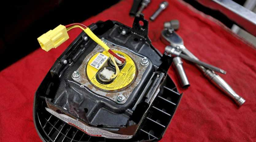 SAFETY RECALL: A recalled Takata airbag inflator; Takata's U.S. units have been automatically shielded from lawsuits since they filed for chapter 11 bankruptcy protection.