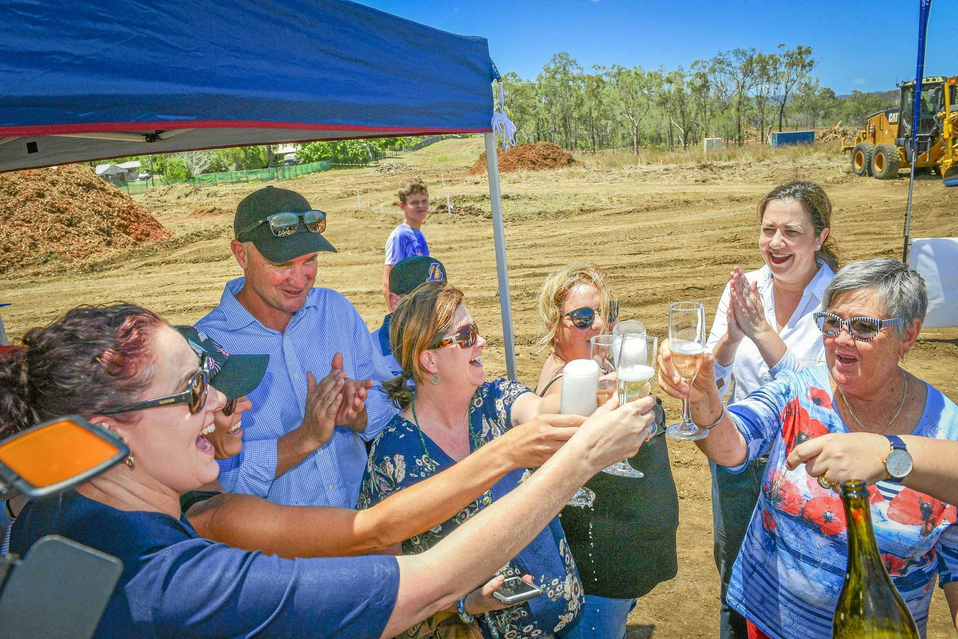 Calliope residents Lynda Ninness, Michelle Burke, Sasha Jorgensen and Bev Dwyer popped open a bottle of champagne with member for Gladstone Glenn Butcher and Queensland Premier Annastacia Palaszczuk to celebrate the turning of the first sod at the Calliope high school project.