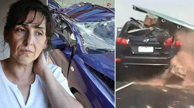 A woman who cheated death when a freeway sign crushed her car has hired lawyers to fight VicRoads and Transurban for compensation.