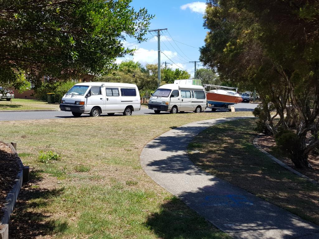 Residents are not happy with these vans and boat, which have been parked on this street at Redcliffe for nine months. Photo: Erin Smith