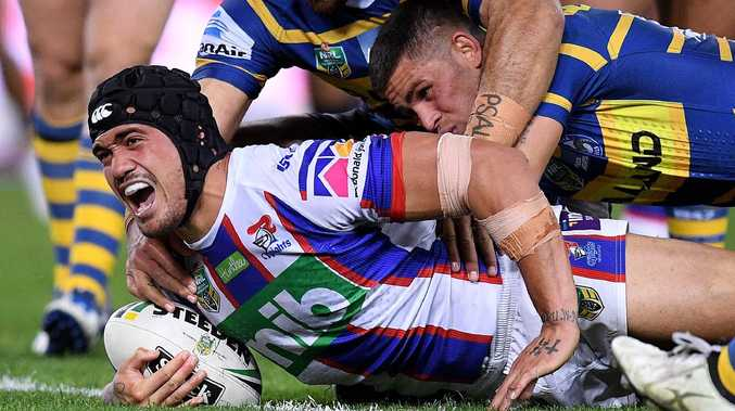 Sione Mata'utia of the Knights scores a try during the Round 13 NRL match between the Parramatta Eels and the Newcastle Knights at ANZ Stadium in Sydney, Saturday, June 2, 2018. (AAP Image/Dan Himbrechts) NO ARCHIVING, EDITORIAL USE ONLY