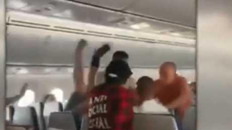 Arrests after violent brawl on Qld flight | Morning Bulletin