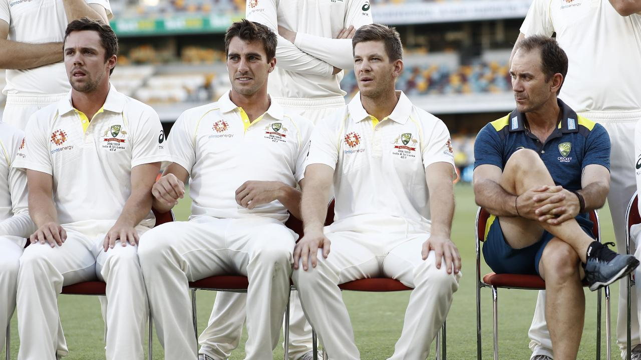 BRISBANE, AUSTRALIA - JANUARY 22: Travis Head, Pat Cummins, Tim Paine of Australia and Justin Langer, coach of Australia, look on during the team photo ahead of the Australia v Sri Lanka Test Series at The Gabba on January 22, 2019 in Brisbane, Australia. (Photo by Ryan Pierse/Getty Images)