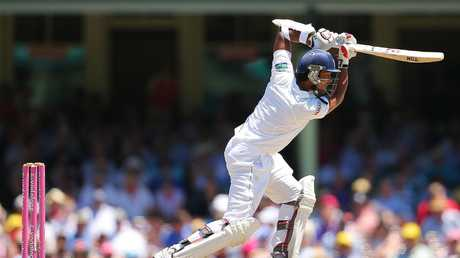 Dinesh Chandimal drives on his way to a half-century against Australia at the Sydney Cricket Ground in 2013.