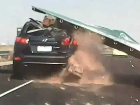 Dashcam footage showing the sign hitting Nella Lettieri's car on the Tullamarine Freeway. Picture: Nine News