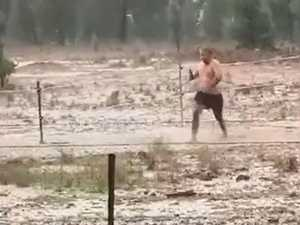 WATCH: Man wildly celebrates rain in drought-stricken Dubbo