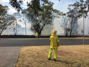 Crews battle a grassfire in Warwick