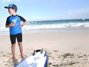 Ability Surf coach Emma Bracken works with Logan