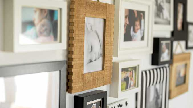 Family photos, elegantly framed and displayed, evoke the personality of the occupier of the home.