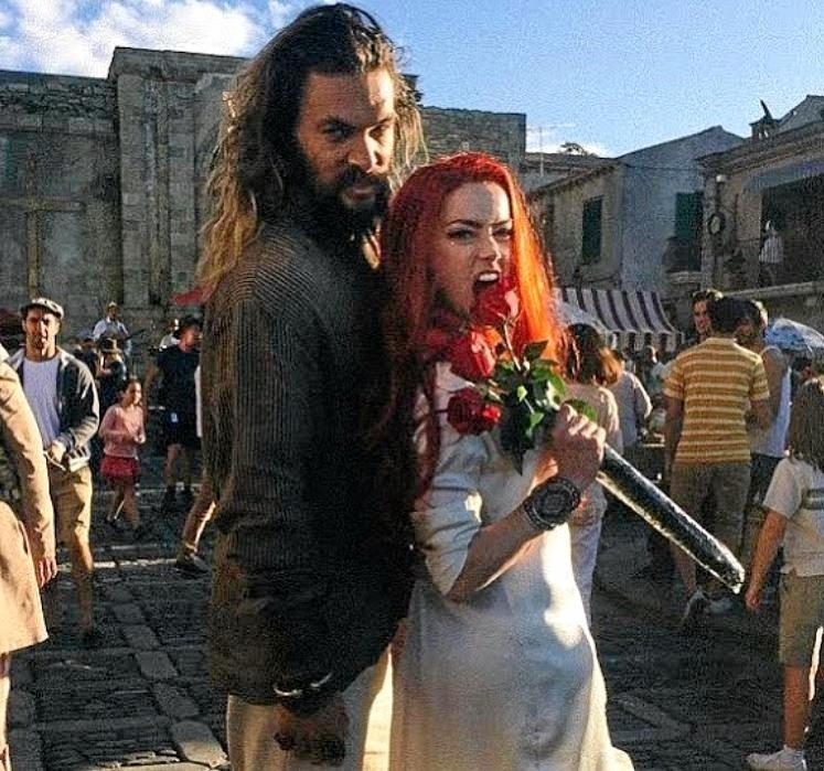 BUDDING ROMANCE: Amber Heard posted a photo with Jason Momoa, saying