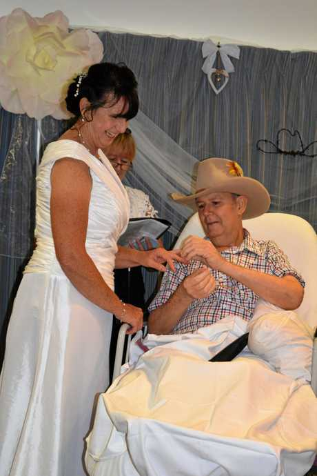 Brad and Patricia Parker  exchange rings at their wedding service at the Biggenden Multi Purpose Health Service on Thursday.