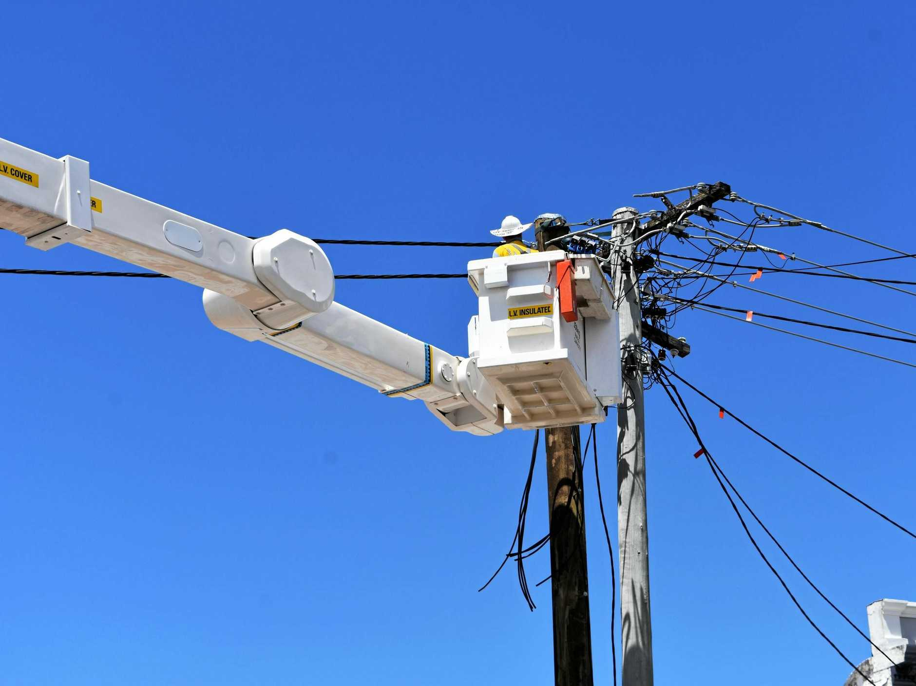 Energex replaces power lines.