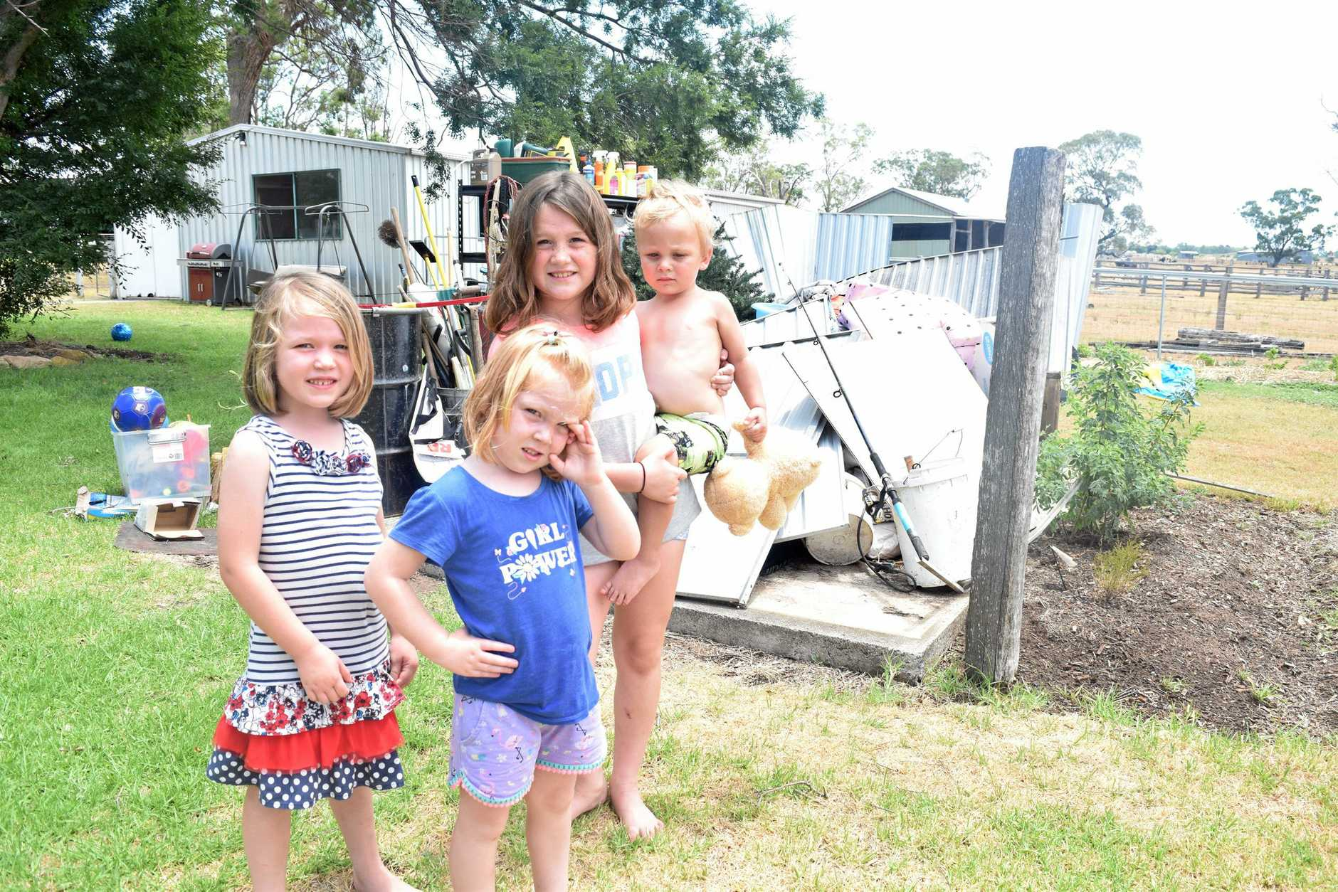 Felicity Madsen and Erin, Marney and Riley Roche with have to find somewhere new to store their Christmas tree after a storm destroyed their garden shed.