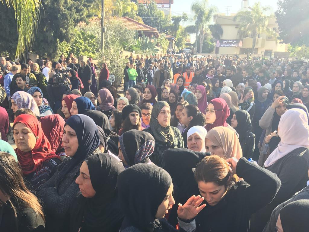 Women gather outside Aiia's familyhome. Picture: Ella Pellegrini