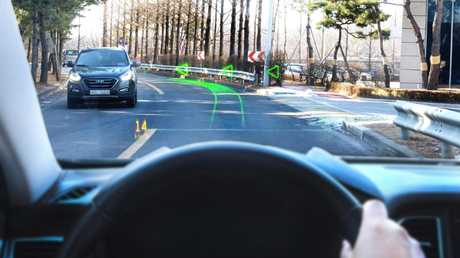 Augmented reality dispays can show directions as if in the real world.