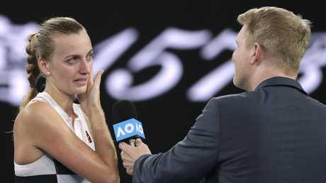 Petra Kvitova sheds a tear as she is interviewed by Jim Courier following her quarter-final victory. Picture: AP