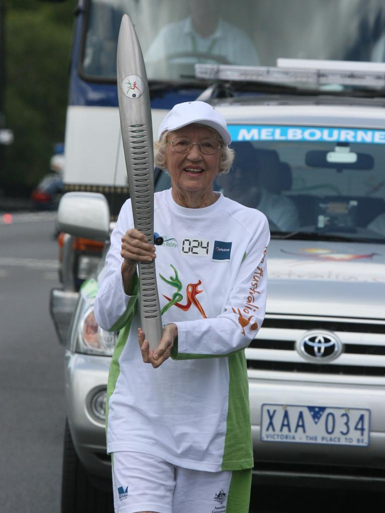Joan running along Coronation Drive at Milton in the Queen's Baton Relay for the 2006 Melbourne Commonwealth Games.