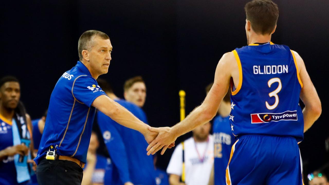 Bullets coach Andrej Lemanis congratulates Cameron Gliddon on a big performance.