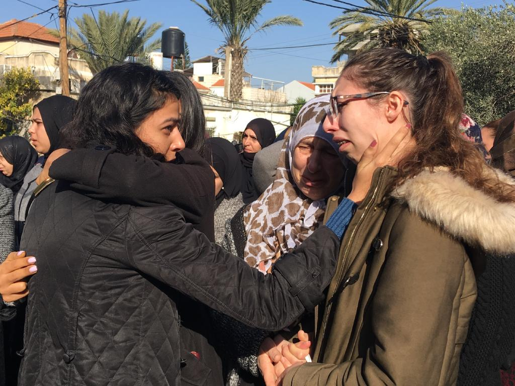 Family and friends react as the coffin of Aiia Maasarwe arrives at her family home in the town of Baqa al-Gharibyye. Picture: Ella Pellegrini